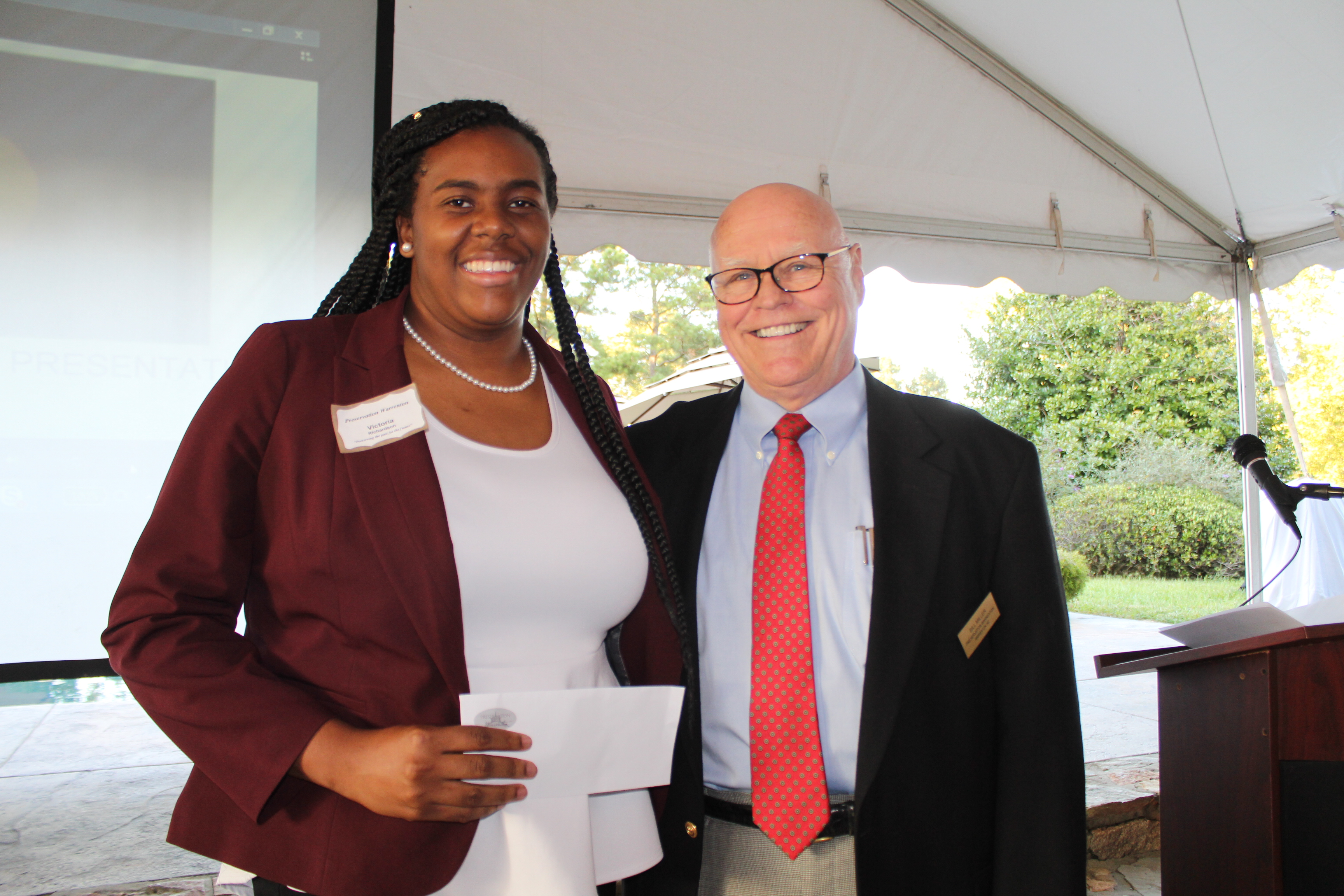 Preservation Warrenton President Bill Miller, right, presents the organization's annual scholarship to Warren County High School 2017 graduate Victoria Richardson.